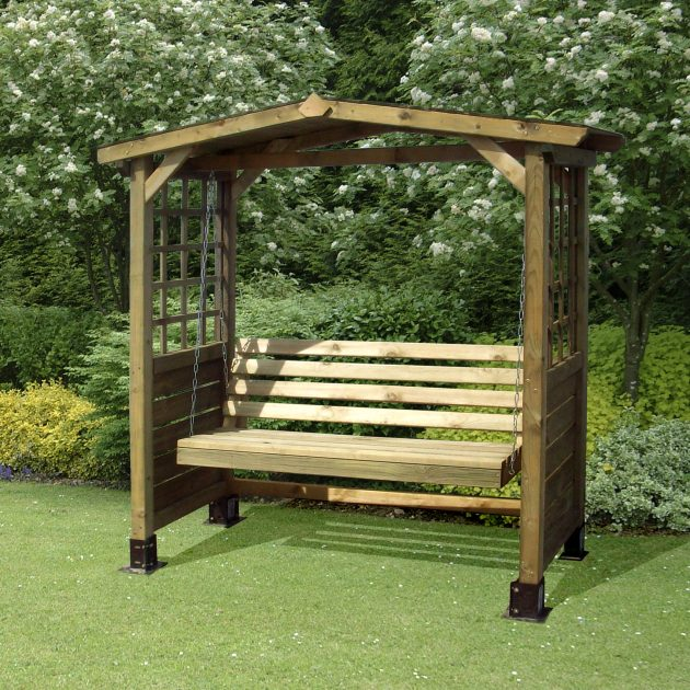 A picture of the Poseidon Swingset Wooden Outdoor Garden Arbour Bench located in a Garden